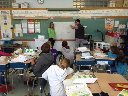 Science Fellows teach class using the board to illustrate