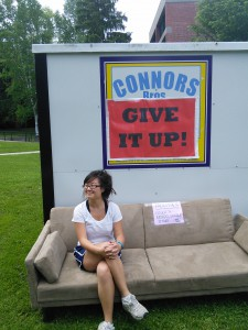 Bianca Brown poses on a coach donated to Give it Up!