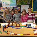 Proud 1st grade students show off their structures